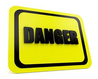 Yellow-black danger sign over a white background.jpeg
